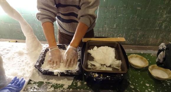 Hongtao Zhou melting wax and preparing wax slush- Photo by Jeff Redmon