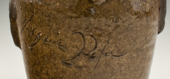 Face jug inscription.