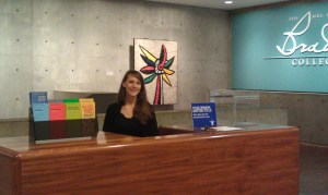 Visitor Services Intern working at the Kahler Information Desk. Photo by Nell Rae.