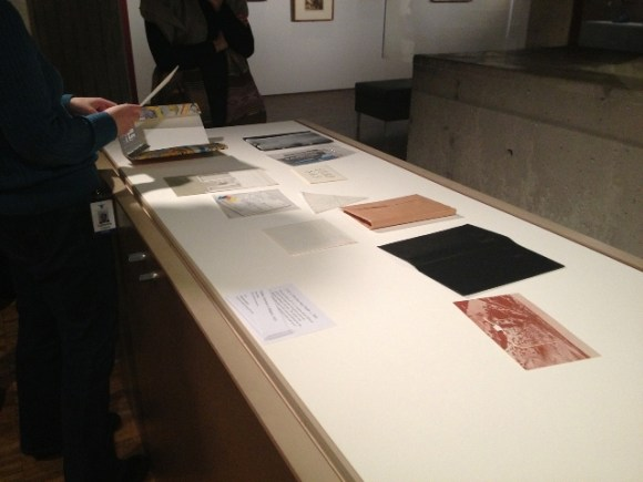 Assistant Curator of Earlier European Art, Catherine Sawinski begins to layout Issue #1 in the case. Photo credit Nate Pyper