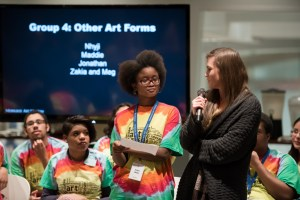 Zakia and Meg read their final project, a poem. Photo by Front Room Photography