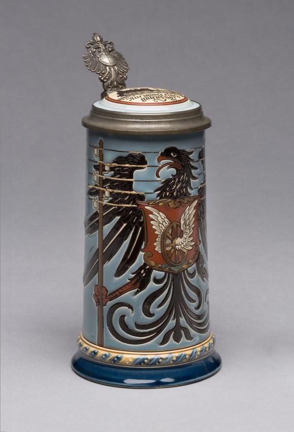 "Villeroy & Boch (Mettlach, Saarland, Germany, established 1836), design attributed to Otto Hupp (German, 1859–1949). ""2075"" Stein, 1900. Stoneware, with colored slip and glaze decoration, gilding, and pewter. Milwaukee Art Museum, Gift of the René von Schleinitz Foundation M1962.567. Photo credit: John R. Glembin."