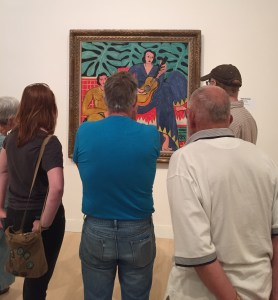 "Museum visitors enjoy Matisse's painting ""La Musique"" which was on view this summer in the exhibition Van Gogh to Pollock: Modern Rebels. Photo by the author."