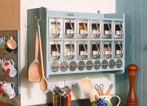 Cabinet with integrated pull-out draws with handles for pasta, grains and herbs kitchen space saver