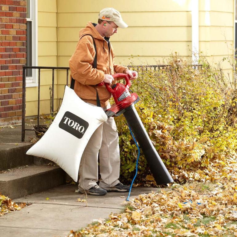 how to deal with autumn leaves falling fall clearing clean autumnal man leaf vacuum