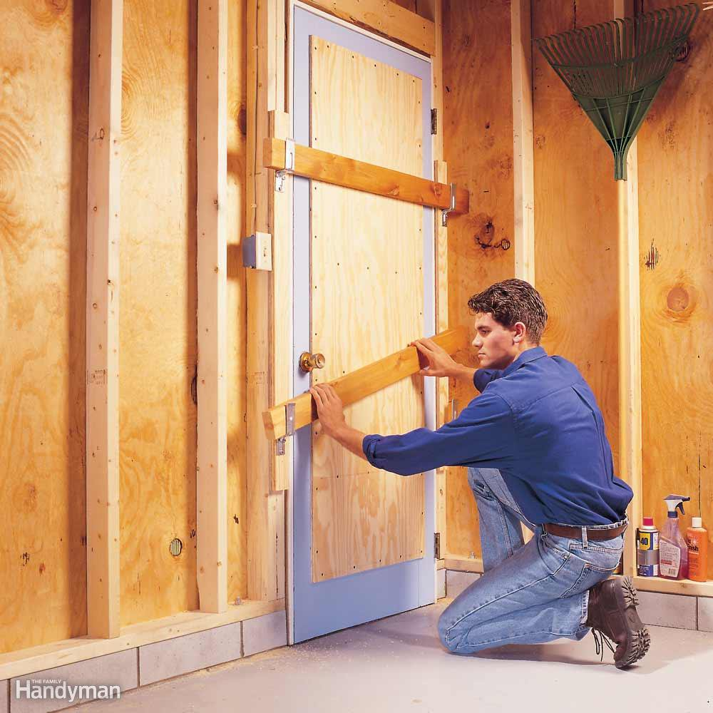 How to Secure Your Home During Winter thehandymano the handy mano manmano mano diy do it yourself protect from burglars garage door reinforce plywood