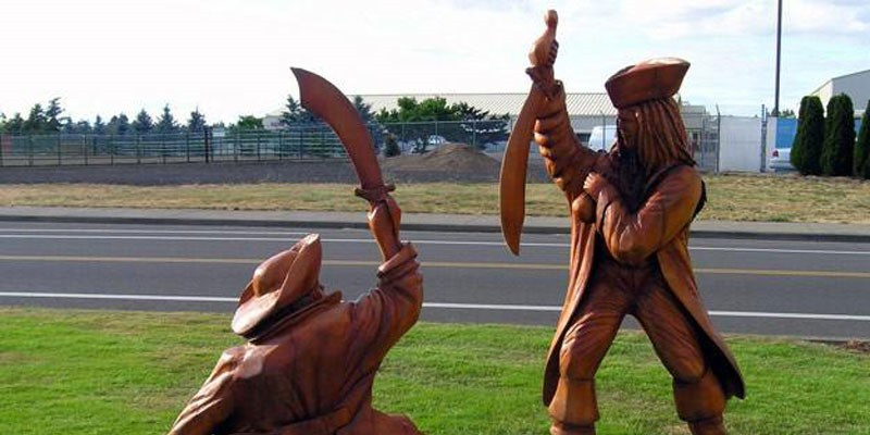 Incredible Chainsaw Carvings wood art artists manomano mano the handy mano pirates caribbean fighting swords