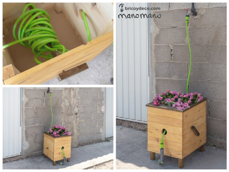 the handy mano manomano DIY planter box with hose reel finished