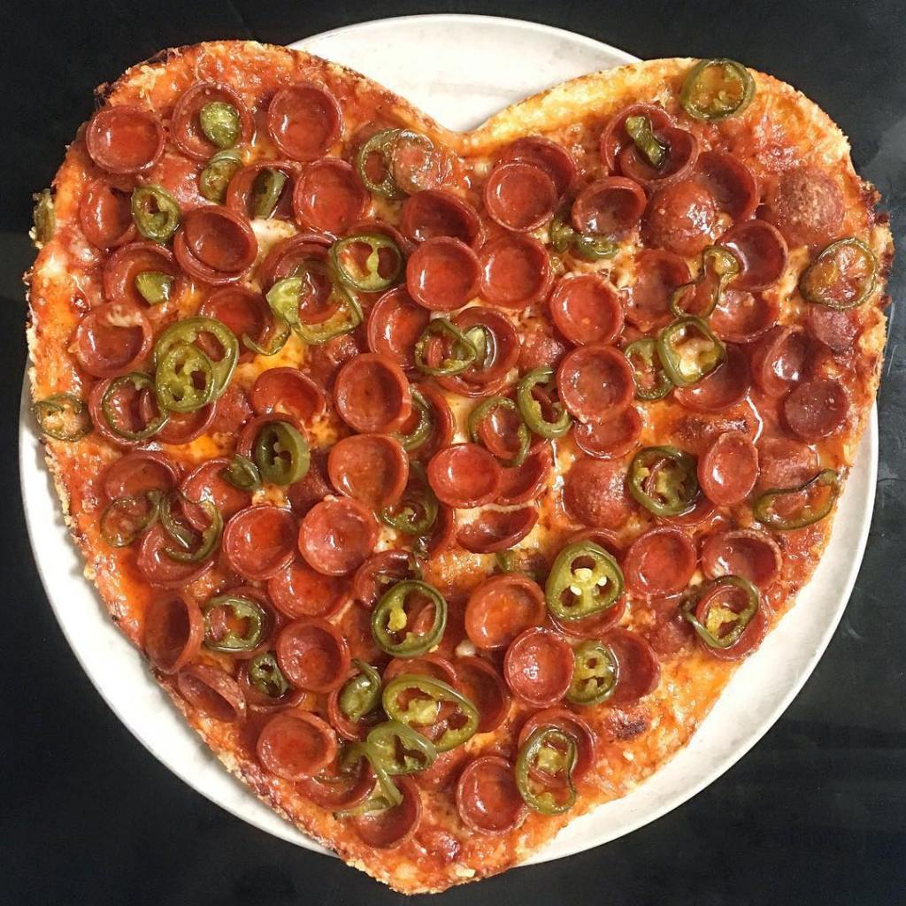 heart-shaped pizza with pepperoni