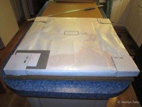 Add cardboard corners, unfolded