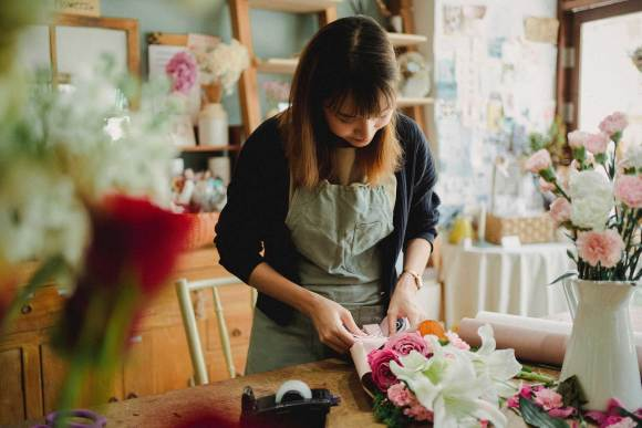 Woman making products with fresh flowers