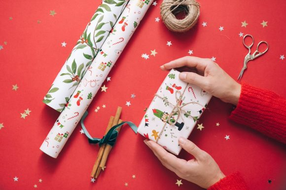 etsy holiday keywords - hands gift wrapping