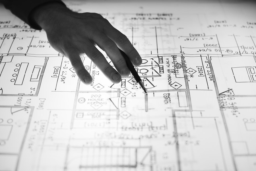 Person looking at floorplans