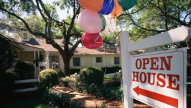 House with Open House sign out and balloons out front