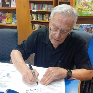 Scottsdale author, Julian J. Blum, signs copies of DYING TO KNOW in Tempe's Changing Hands bookstore.