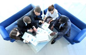 A stakeholder team compares notes.