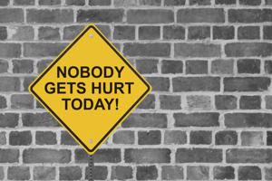 """A sign saying """"Nobody gets hurt today!"""""""
