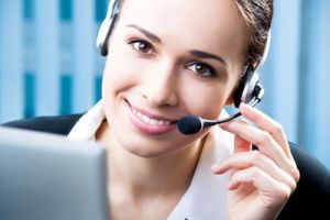 woman smiling while wearing a phone headset