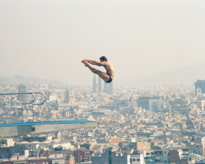 Scott Donie competes in the 1992 Olympics, high above the city of Barcelona. Photo Credit: Rol Donie.