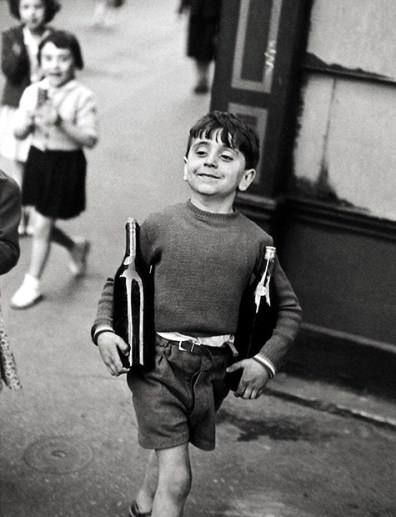 Rue Mouffetard, Paris, 1954, Cartier-Bresson's famous photo of a boy proudly strutting with a bottle of wine under each arm