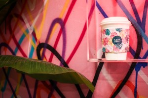Photo of a Calii Love coffee cup.