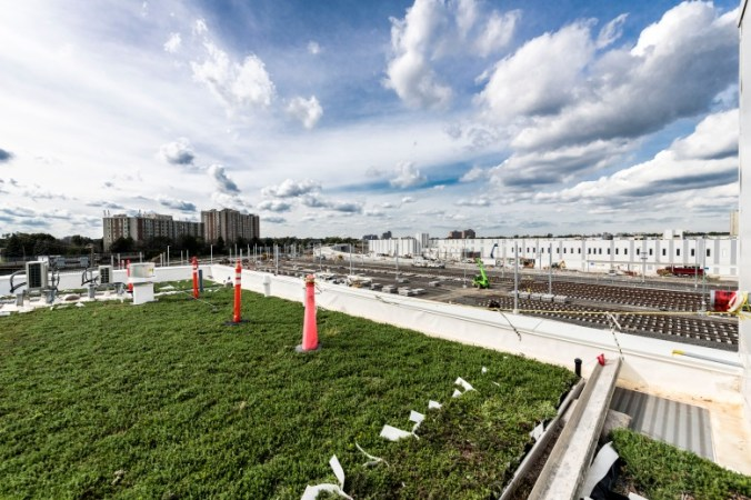 Grass is seen growing on the environmentally friendly green roof of the EMSF.