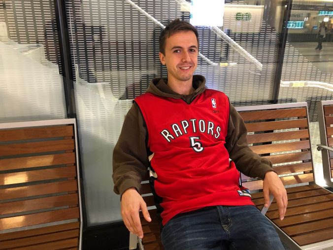 Scott relaxes in his Raptors shirt, inside Union Station.