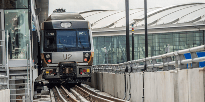 The image shows an UP train parked at Pearson.