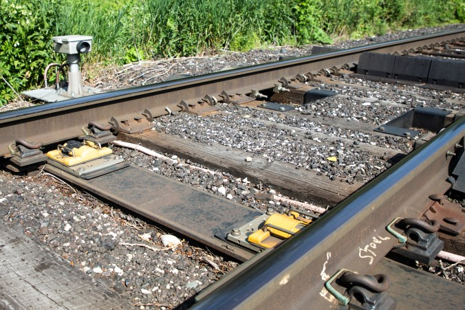 Photo of the train tracks and a hot dox device setup next to the rails.