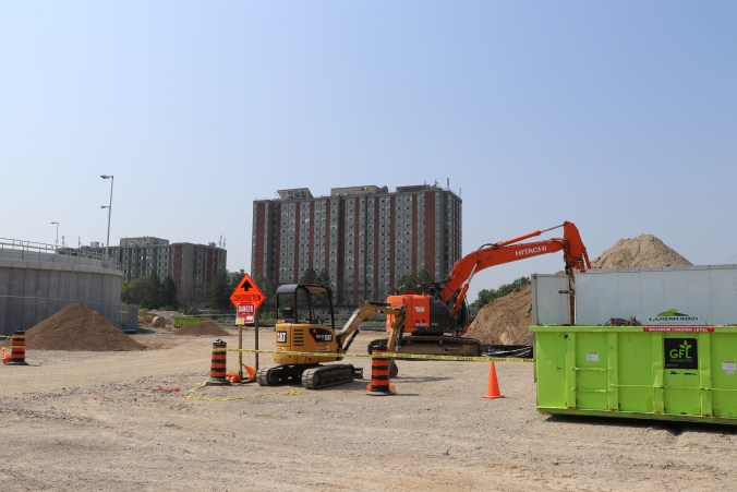 Bulldozers work on the back-up power facility for the Crosstown LRT