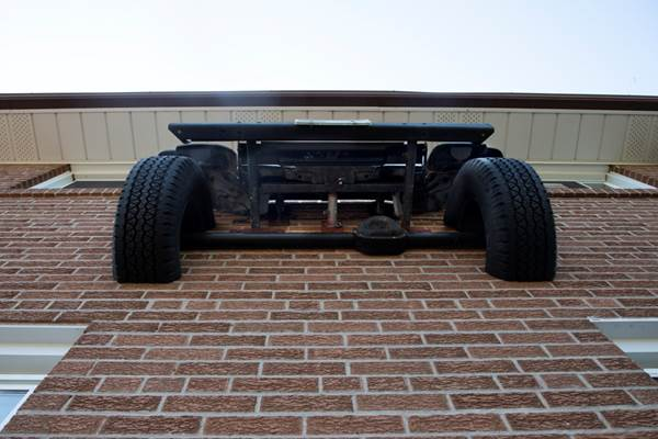 A view looking up under the Jeep, and the supports holding it.