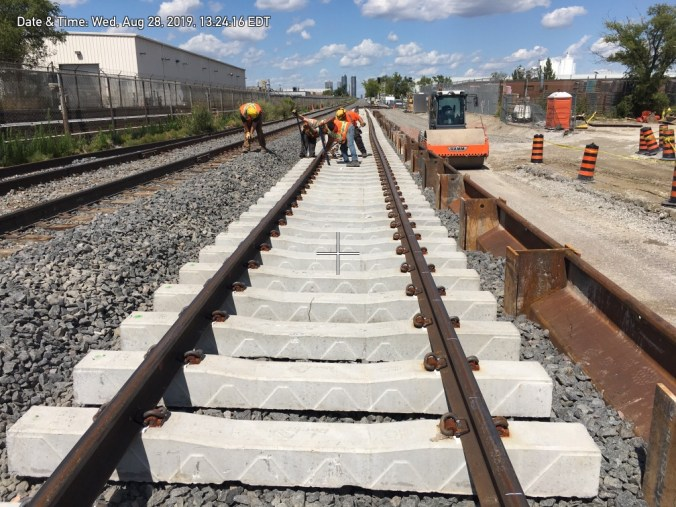 Crews work on the new second rail.