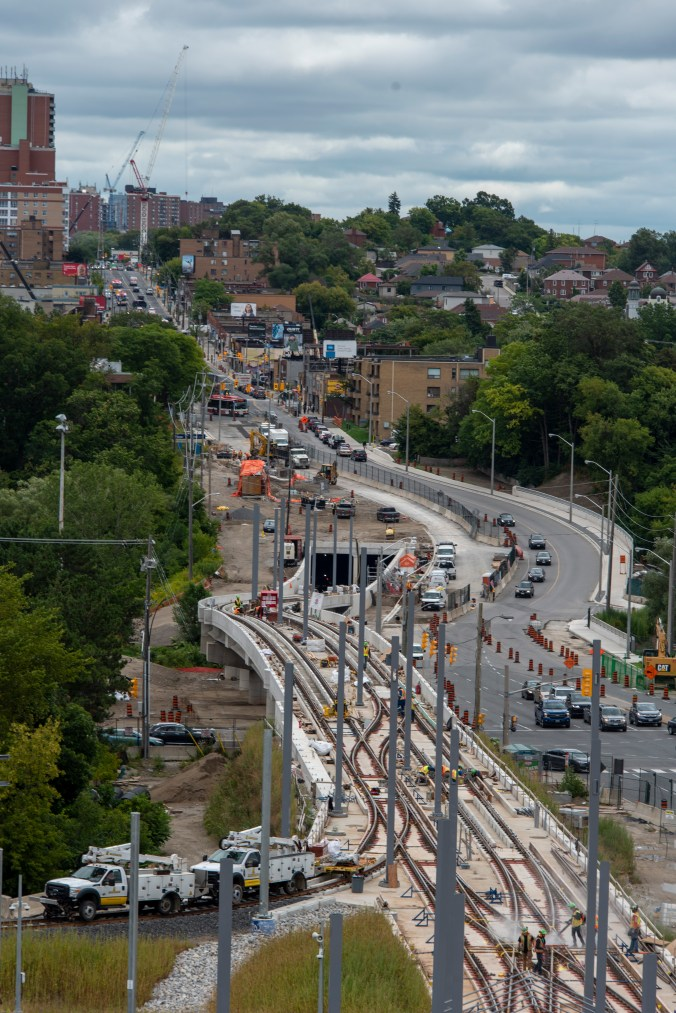 Crews work on a section of Crosstown where the route comes out or two tunnels.