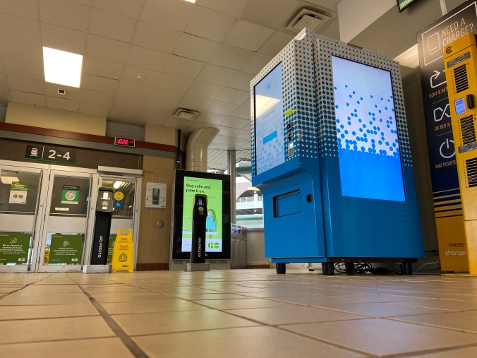 Image shows a vending machine in a station lobby.
