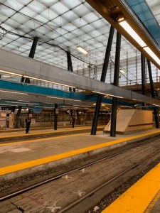 New lighting is suspended above two Union Station platforms.