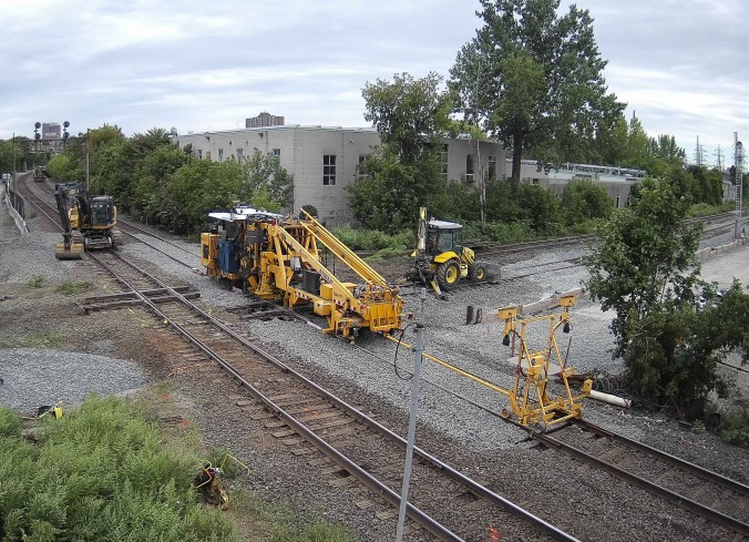 Track is put down by a large machine.