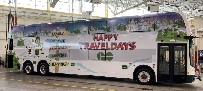The GO bus with all the wraps completed. The words 'Happy Holidays' is written on the side.