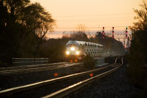 A GO train makes a run along tracks during an early morning commute.
