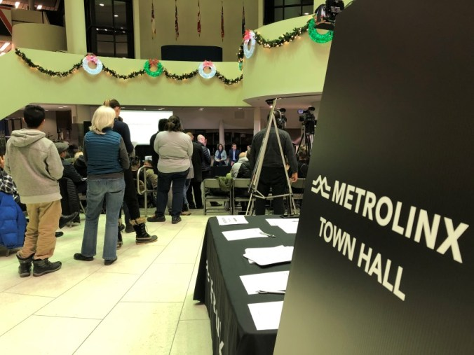 A sign points the way to the Metrolinx town hall