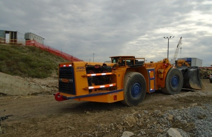 A tractor moves across the construction site.