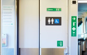 A picture of a toilet door on a GO train.