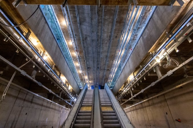 Image shows escalators heading to upper level.