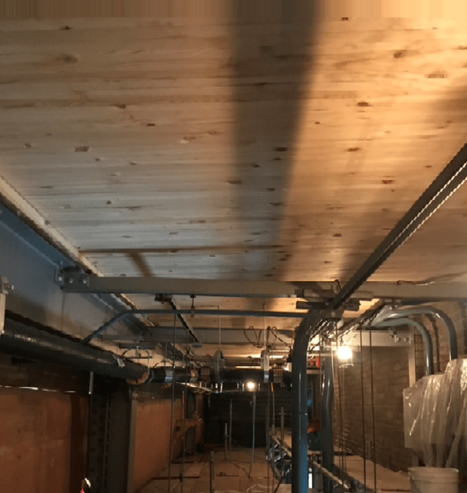 Image shows a wooden ceiling.