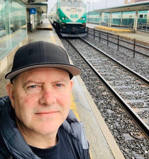 Photo of Toronto Police Sgt. Chris McCann on the GO platform as the train approaches
