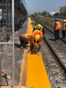 Image shows crews working on yellow lines.