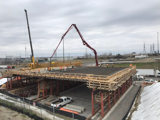Image shows a construction aea, with crews working on the top part.