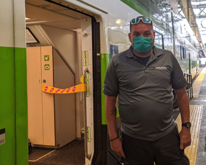 GO customer service ambassador poses with a mask
