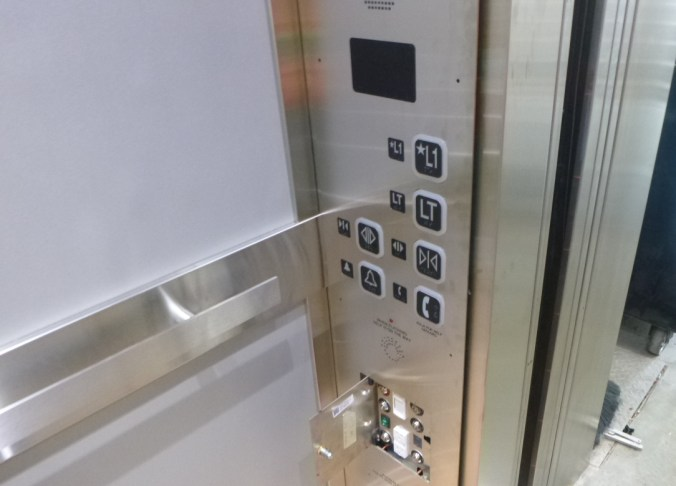 photo of the elevator buttons inside the elevator at Oakville GO
