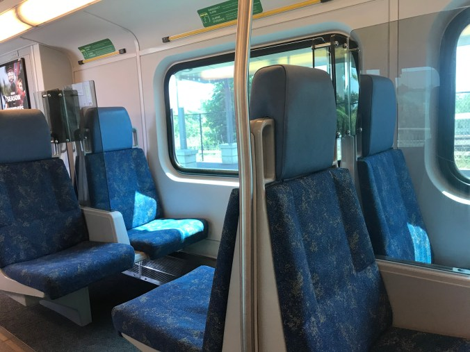 Photo of new clear plastic dividers between seats on GO Train are being rolled out on some GO Trains