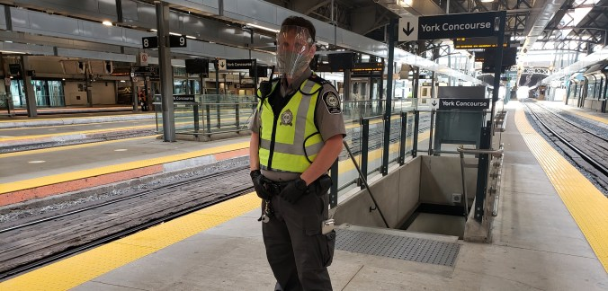 GO Transit fare inspector with face coverings, face shields, gloves